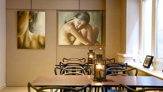 Salle à manger avec tableaux Hôtel la Maison des Armateurs